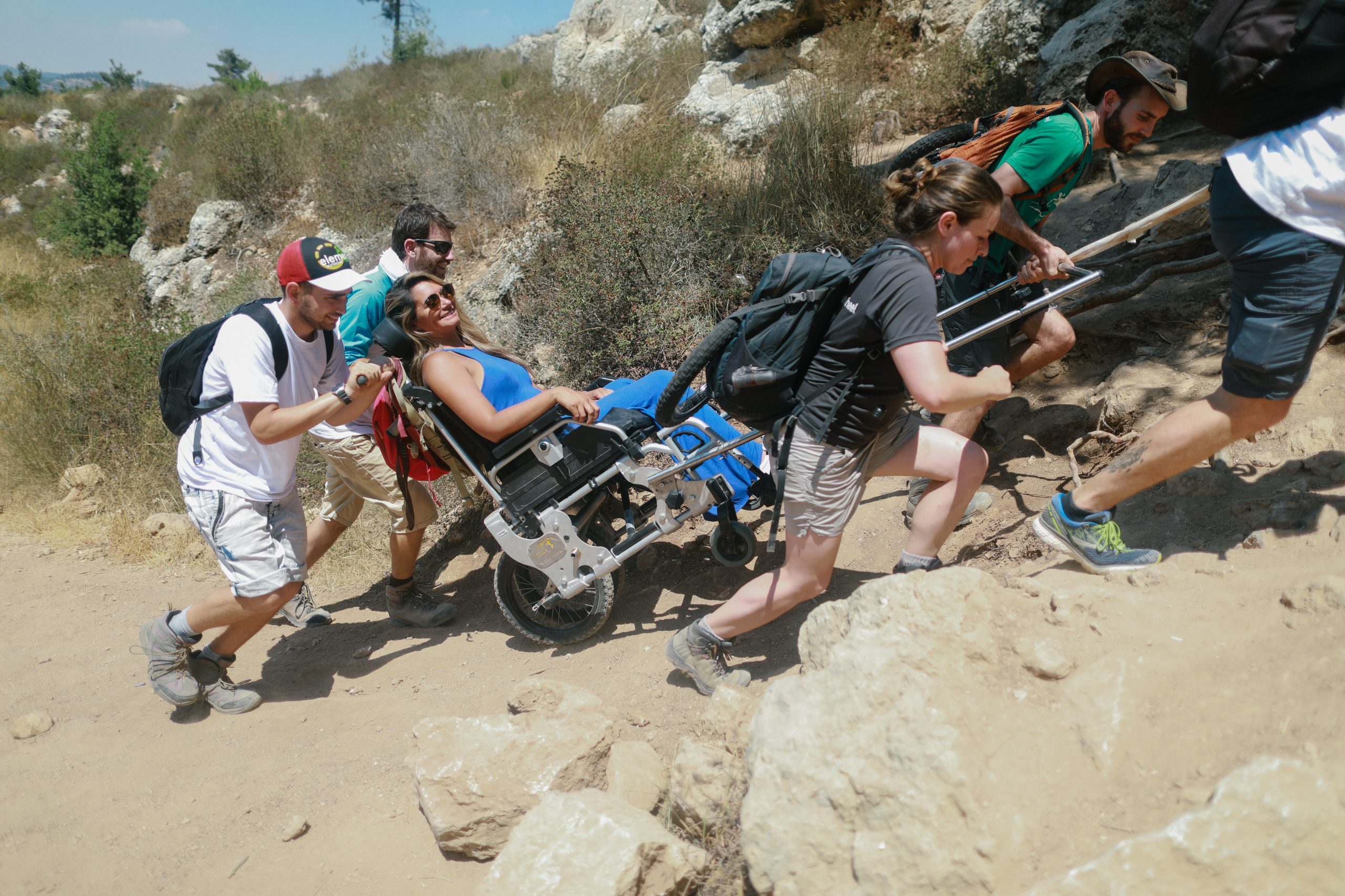 "<img src=""Hikers assisting someone in a Trekker.jpg"" alt=""Group of hikers helping to get someone in a Trekker up a slope"">"