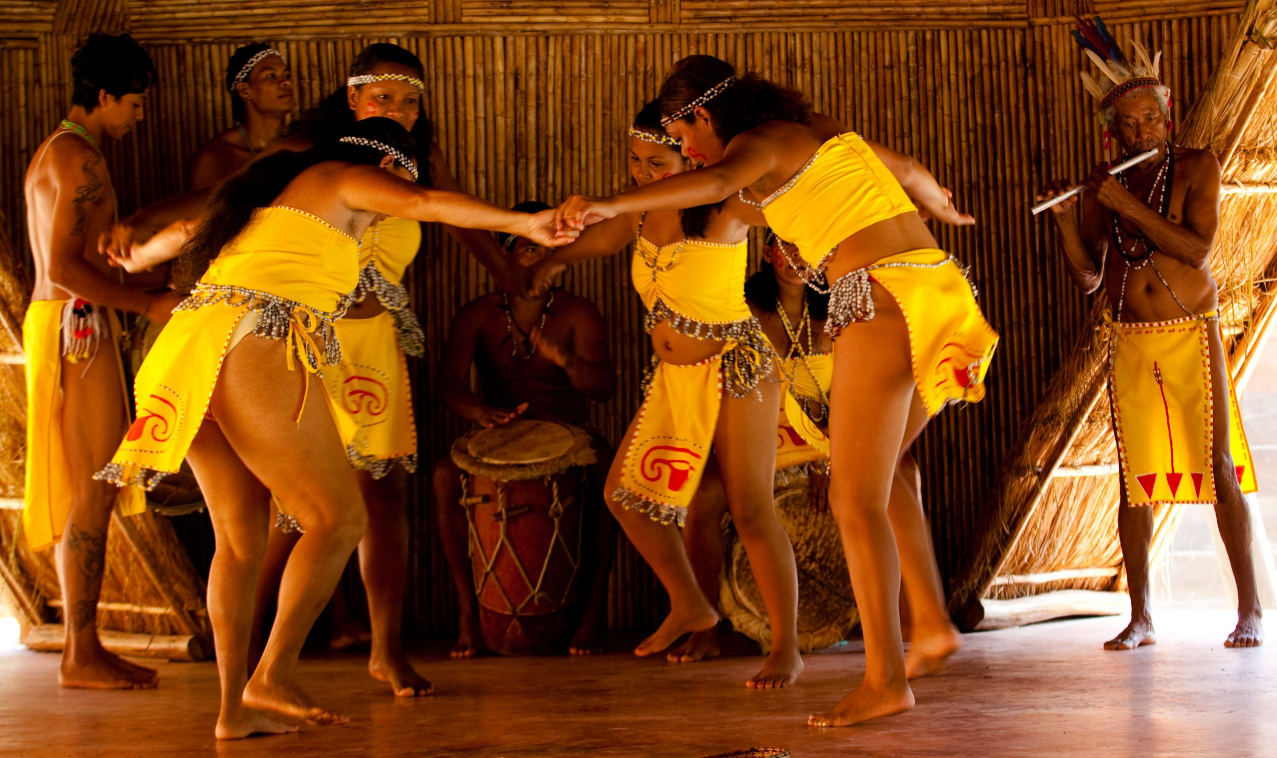 A Kalinago Dance done by Kalinago ladies in yellow traditional wear