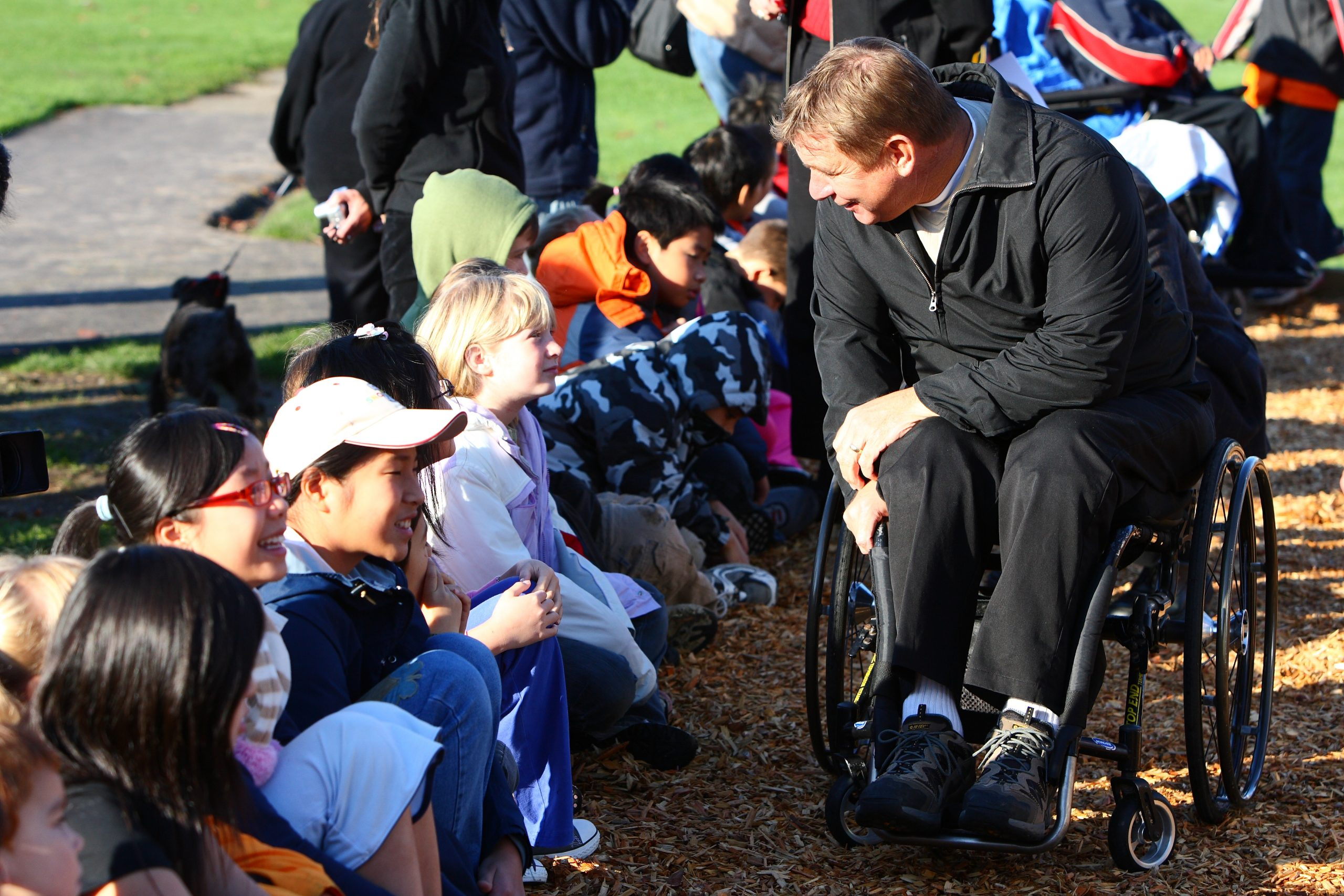 Rick Hansen interacting with children
