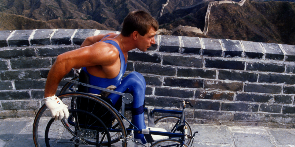 Rick Hansen wheeling along the Great Wall of China