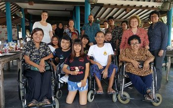 Joyce Bender with children with disabilities in Indonesia